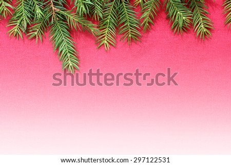 New Christmas background with real pine tree branches in red and white - stock photo