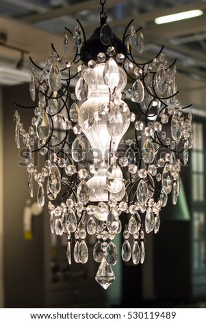 New Chrystal chandelier with lights on on dark background