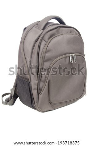 New closed brown backpack isolated on white  - stock photo