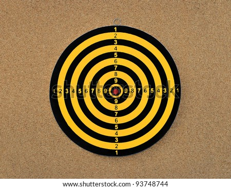 New Colorful Dart board with score numbers isolated on cork board background - stock photo