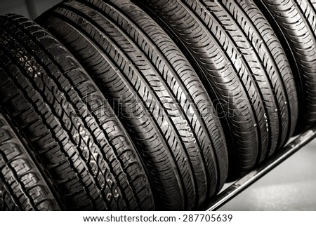 New Compact Vehicles Tires Stack. Winter and Summer Season Tires. - stock photo