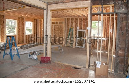 New construction addition being added to old home - stock photo
