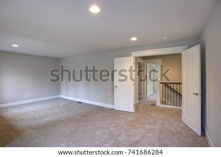 New construction home interior features empty stock photo new construction home interior features empty room with light grey walls paint color and beige carpet aloadofball Gallery