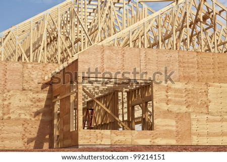 New construction of a wooden building or house. - stock photo