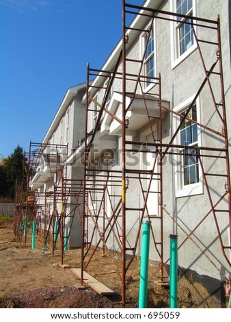 NEW CONSTRUCTION OF TOWNHOUSES - stock photo