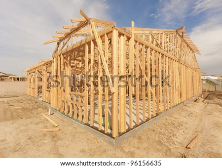 New Construction Wood Home Framing Abstract. - stock photo