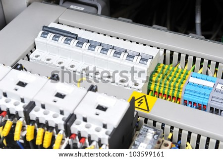 New control panel with  electrical equipment. Automatic electricity switchers - stock photo