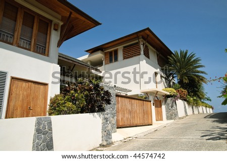 new cottage in tropical garden - stock photo