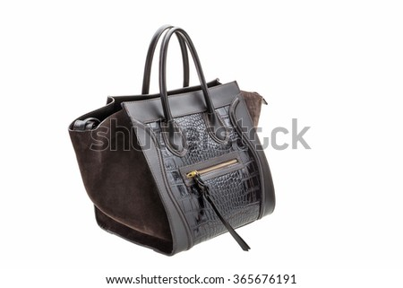 New dark Brown leather womens bag with crocodile texture isolated on white background. - stock photo