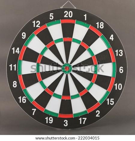 New dart board on dark gray background without arrow .  - stock photo