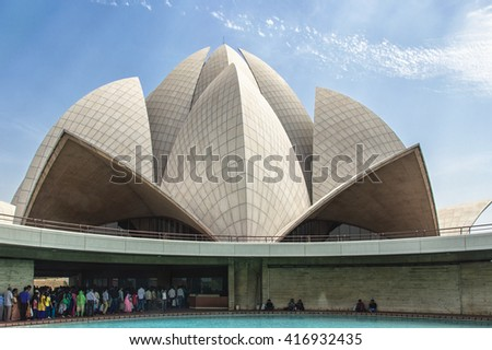 New Delhi, India - April 16, 2016: Visitors at The Lotus Temple, located in New Delhi, India. It is a Bahai House of Worship completed in 1986. Lotus It is open to all people, regardless of religion.  - stock photo