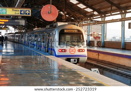 NEW DELHI, INDIA, DEC - 5, 2014: Delhi Metro station. Delhi Metro is the network consists of five colour-coded lines (Red, Blue, Green, Yellow, Violet), plus a sixth Airport Express line
