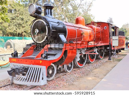 New Delhi, India - January 9, 2016: Antique rail engine, wheel, coache, saloon and best preserved steam locomotive engines of its age in National Rail Museum.