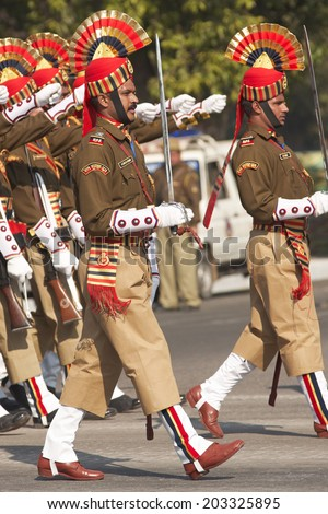 NEW DELHI, INDIA - JANUARY 23, 2008: Soldiers in bright red and gold headdress parading down the Raj Path in preparation for the annual Republic Day Parade in New Delhi, India - stock photo