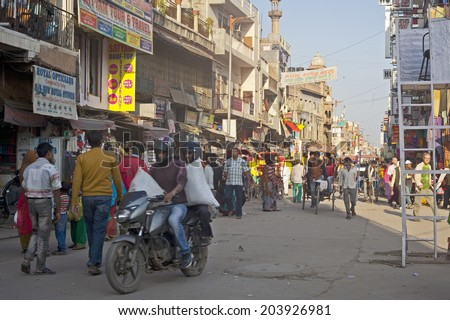 NEW DELHI, INDIA - October 10, 2013: View to crowded street with shops, hotels, transport and people in Main Bazaar or Paharganj.  - stock photo