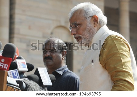 NEW DELHI-MAY 20:  Prime Minister Narendra Modi being guarded by his body guards  at Rashtrapati Bhavan during a press conference on May 20, 2014 in New Delhi , India.  - stock photo