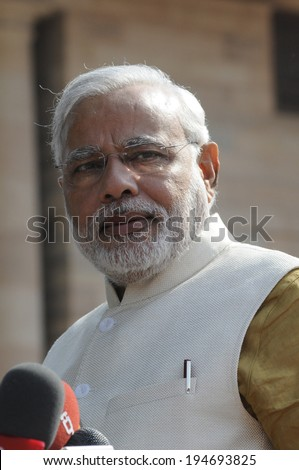 NEW DELHI-MAY 20:  Prime Minister Narendra Modi looking at the reporters at Rashtrapati Bhavan during a press conference on May 20, 2014 in New Delhi , India.  - stock photo
