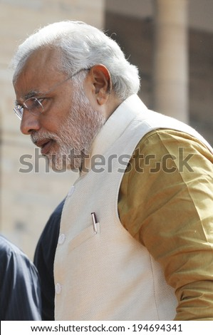 NEW DELHI-MAY 20:  Prime Minister Narendra Modi stepping up to attend a press conference at Rashtrapati Bhavan on May 20, 2014 in New Delhi , India.  - stock photo