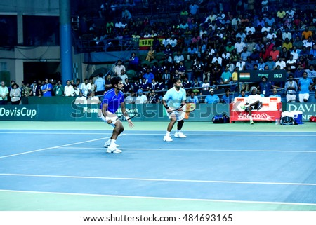 NEW DELHI - SEPTEMBER 17, 2016: Saketh Myneni and Leander Paes play for India against Spain in the Davis Cup 2016 doubles match at the R.K. Khanna Tennis Stadium, New Delhi.
