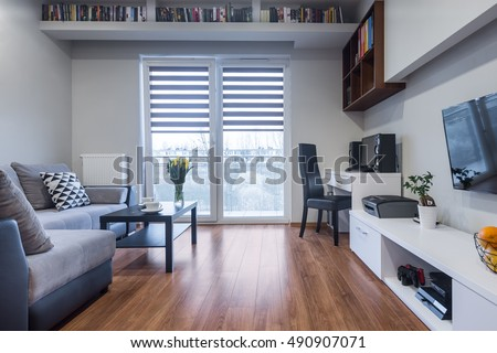 New design home interior with window, TV, large sofa and white furniture set