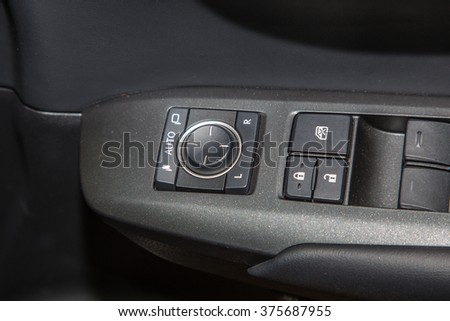 New design of lock unlock, car window control buttons and  Interior details in modern car close up view. - stock photo