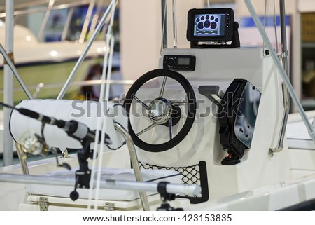 new design of steering wheel for boat; note shallow depth of field
