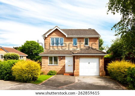 New detached house with garage - stock photo