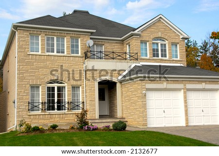 New detached single family luxury home with stone facade and double garage
