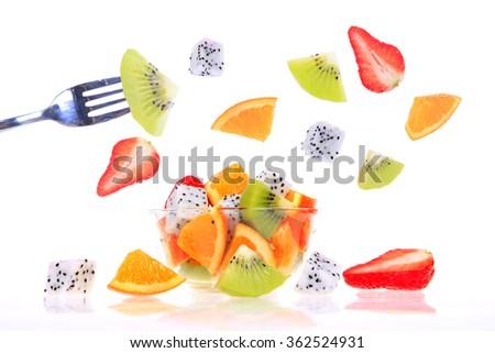 New dragon fruit, kiwi and oranges, consisting of a fruit salad - stock photo