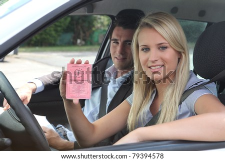 New driver displaying French licence - stock photo