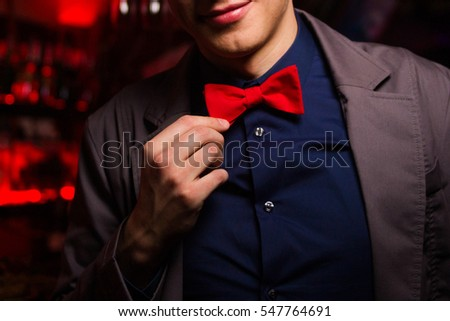 new elegance red  bow tie on adult man indoor
