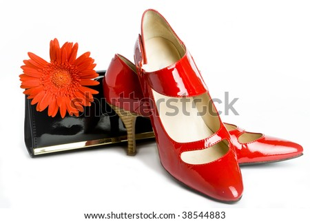 new elegant Shoes on a high heel and varnished leather handbag and flower - stock photo