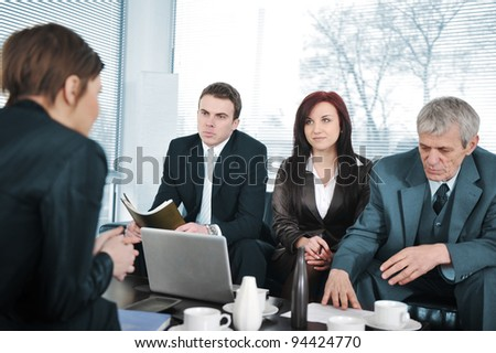 New employee in an interview with three business people
