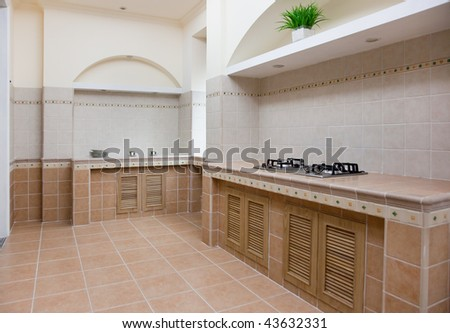 New empty modern kitchen with gas stove in a new house - stock photo