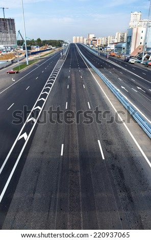 New empty road and overpass in the background - stock photo