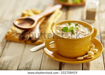 new england clam chowder with oyster crackers in yellow bowl - stock photo