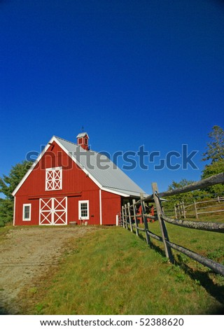 New England red barn and fence against blue sky.Mount Desert Island, Acadia National park, Maine, New England