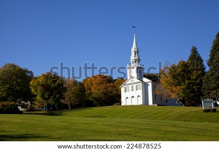 New England white church in the autumn season - stock photo