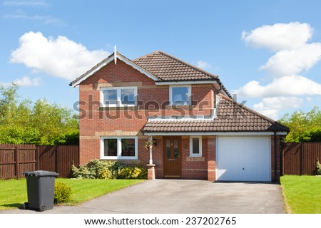 New english detached house with garage and garden - stock photo