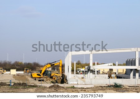 new factory construction site with workers - stock photo