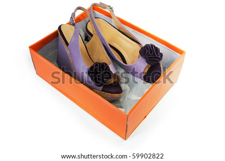 New female sandals on a high heels in a box isolated on white background - stock photo