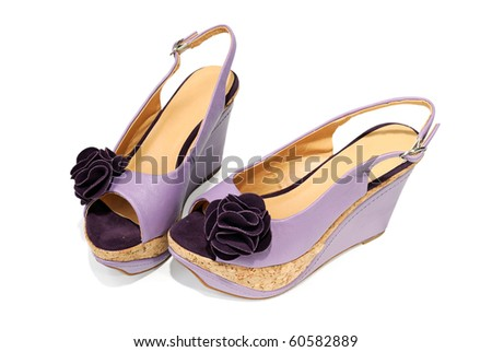 New female sandals on a high heels isolated on white background - stock photo
