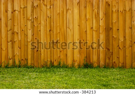 New fence in the backyard in landscape format - stock photo