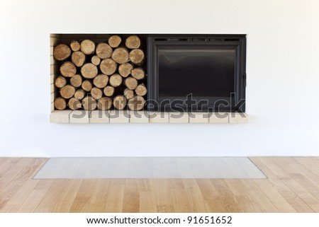 new fireplace with wooden logs - stock photo