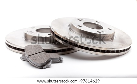 New front brake disks and pads for a modern car - stock photo