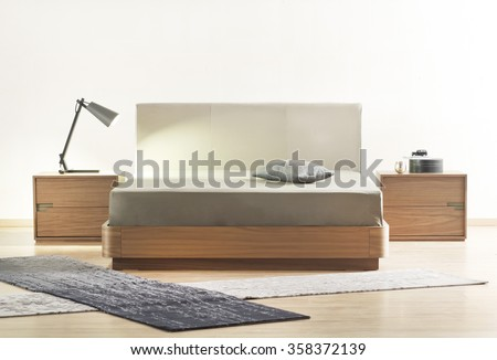 NEW FURNITURE LINE . MODERN DESIGN . STRAIGHT LINES . MATERIALS : WOOD ,  FABRIC . ITEMS : BED , BEDSIDE TABLES - stock photo