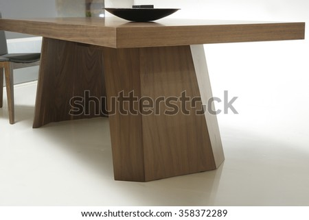 NEW FURNITURE LINE . MODERN DESIGN . STRAIGHT LINES . MATERIALS : WOOD ,  FABRIC, LEATHER . ITEMS : TABLE WITH CHAIR SET - stock photo