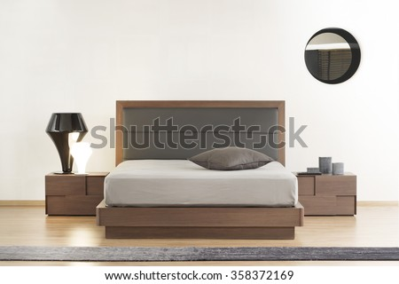 NEW FURNITURE LINE . MODERN DESIGN . STRAIGHT LINES . MATERIALS : WOOD , METAL, FABRIC . ITEMS : BED , BEDSIDE TABLES - stock photo