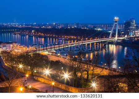 New Futuristic Bridge in Bratislava at Twilight - stock photo
