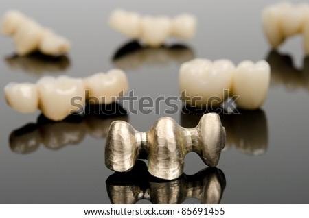new gold bridge and finished prosthetics - stock photo